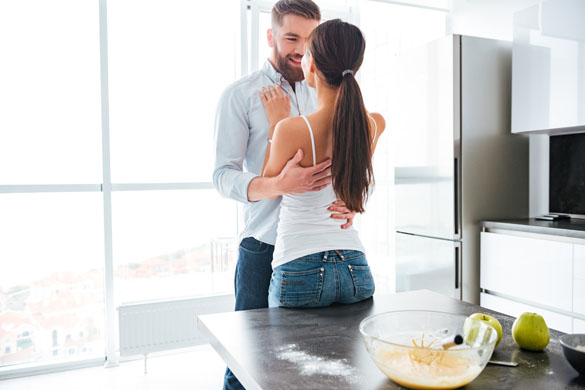 cuddling-virgo-man-and-his-girlfriend-in-kitchen-near-the-table
