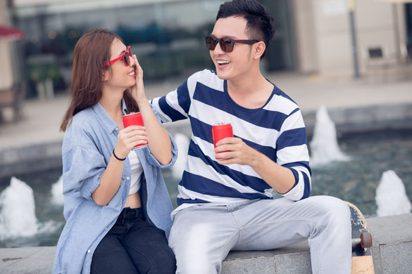 virgo-man-and-his-girlfriend-sitting-with-bottle-of-beverage-and-having-fun-outdoors