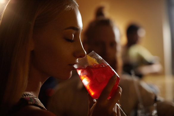 Close-up profile of glamorous blonde girl enjoying fresh fruit drink - how to flirt with a Virgo man and make eye contact