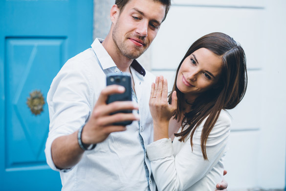 Young couple taking a selfie after engagement proposal - How To Make A Virgo Man Want To Marry You