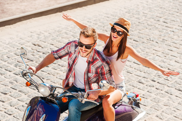 beautiful young couple riding scooter together - signs a virgo man is falling in love with you
