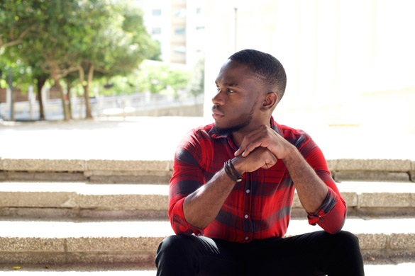pensive young african man sitting outdoors on steps and looking away - Why A Virgo Man Ignores Your Text Messages