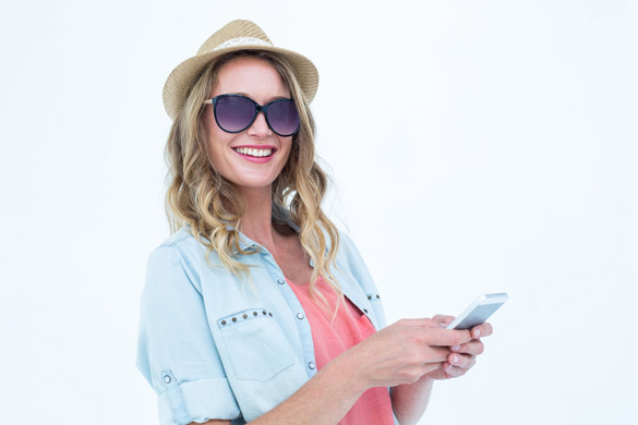 Smiling woman texting with her smartphone - What is the Right Way to Text a Virgo Man