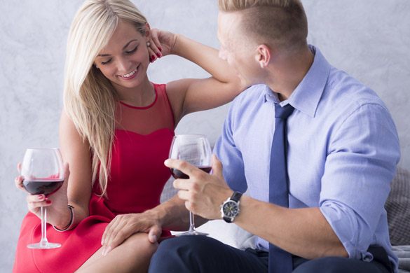 Young couple flirting and drinking wine on a bed - who makes the first move the virgo man or you