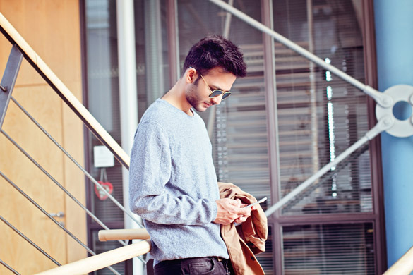 business man texting on smartphone - What is the Right Way to Text a Virgo Man